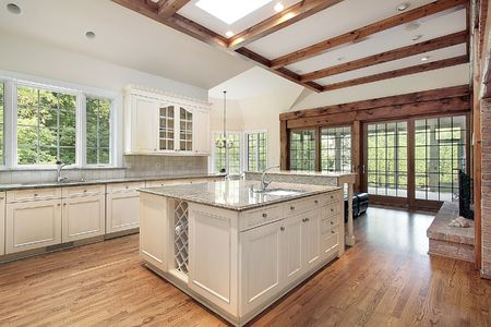 Kitchen in new construction home with ceiling wood beams photo