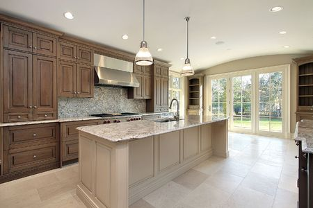 kitchen island: Kitchen in new construction home with large marble island