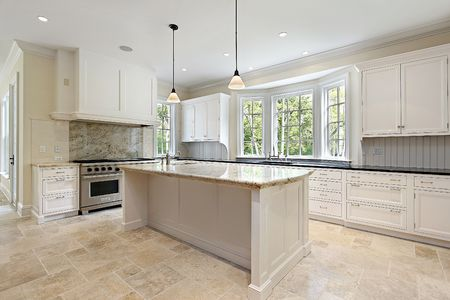 Kitchen in new construction home with granite island Stock Photo - 6740301