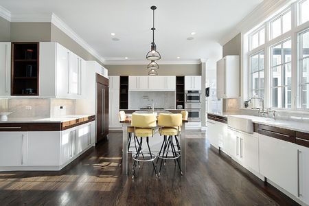 real kitchen: Kitchen in luxury home with white cabinetry Stock Photo