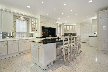 Kitchen in luxury home with black top marble island