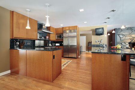 Kitchen in luxury home with black backsplash photo