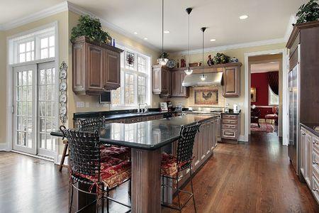 kitchen island: Elegant kitchen in luxury home with black marble island