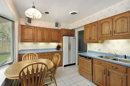 Kitchen in suburban home with wood cabinetry Stock Photo - 6739843