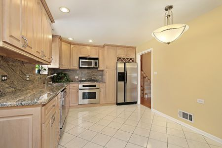 Kitchen in suburban home with oak wood cabinetry Stock Photo - 6740120