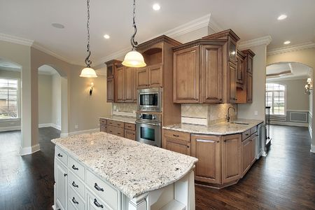 Kitchen in new construction home with granite island Stock Photo - 6740103