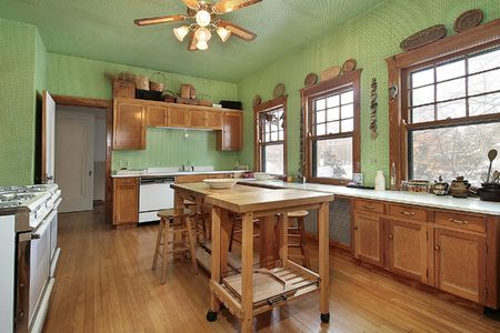 Kitchen with green walls and wood island Stock Photo - 6739884