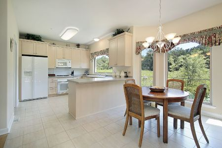 eating area: Kitchen with eating area and forest view Stock Photo