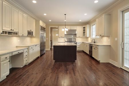 Kitchen in new construction home with light wood cabinetry photo