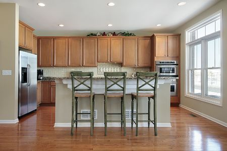 Kitchen in luxury townhouse with granite island Stock Photo - 6739654