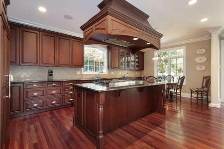 豪華なストーブの島で家の台所 写真素材