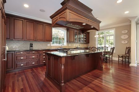 stove: Kitchen in luxury home with island stove