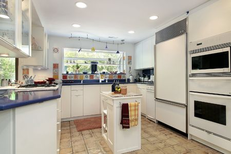 Kitchen in contemporary home with blue coutertops photo