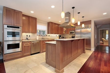 cabinetry: Kitchen in luxury home with oak wood cabinetry Stock Photo