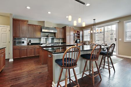 island: Kitchen in luxury townhome with two islands