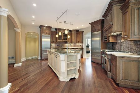 kitchen island: Kitchen in new construction home with L-shaped island Stock Photo