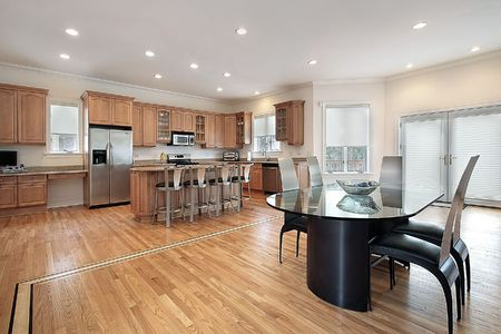 Large kitchen with eating area and oak wood cabinetry Stock Photo - 6739788