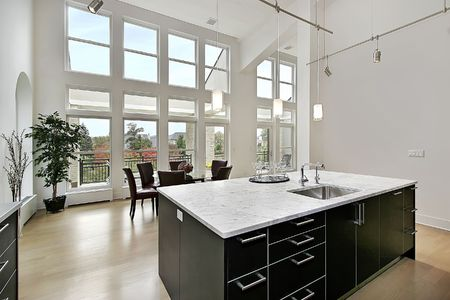 on kitchen: Modern kitchen in condominium with two story windows