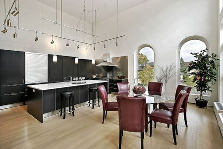 cabinetry: Kitchen in luxury condominium with black cabinetry Stock Photo