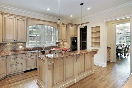 kitchen island: Kitchen in new construction home with double-tiered island Stock Photo