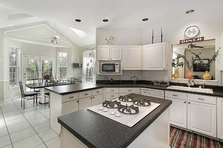 kitchen island: Kitchen in suburban home with white cabinetry