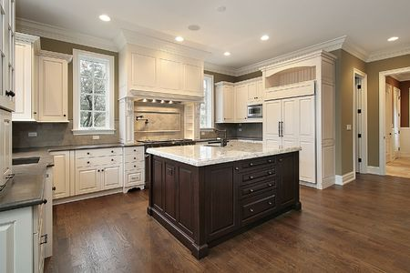 Kitchen in new construction home with wood and granite island Stock Photo - 6739663