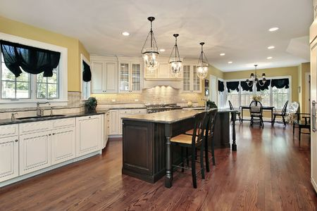 Large kitchen with island and eating area Stock Photo - 6739640