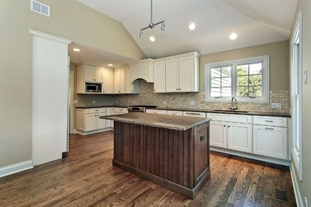 Kitchen in new construction home with middle island photo