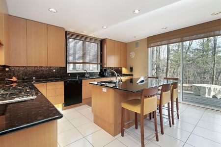 Kitchen in luxury home with orange cabinetry
