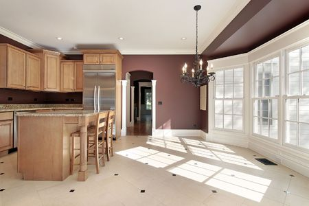 Kitchen in new construction home with large eating area photo