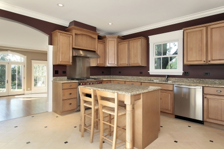 granite: Kitchen in new construction home with granite and wood island Stock Photo