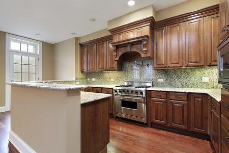 contemporary kitchen: Kitchen in new construction home with granite backsplash