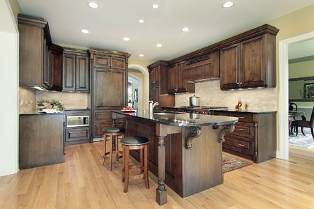 Kitchen in new construction home with granite island top Stock Photo - 6739817