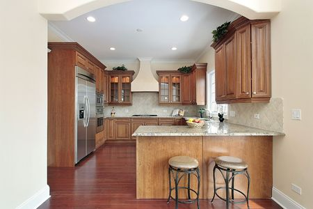 Kitchen in new construction home with arched entry photo