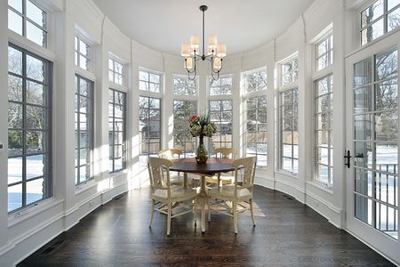 Large eating area with wall of windows in luxury home photo