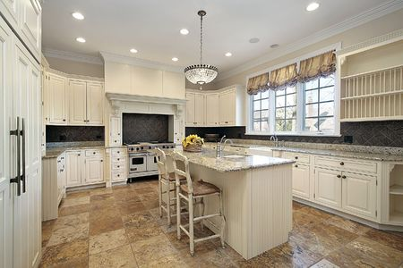 Kitchen in luxury home with light wood cabinetry Stock Photo