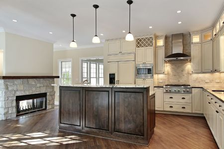 residential: Kitchen in new construction home with stone fireplace