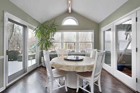 6739648: Eating area in suburban home with doors to patio