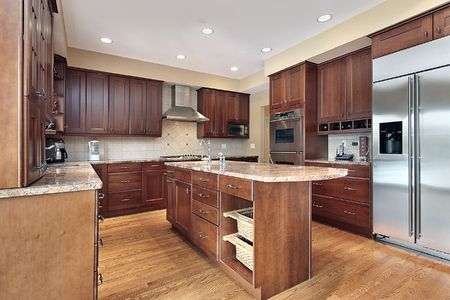 Kitchen in luxury home with cherry wood cabinetry Stock Photo - 6739826