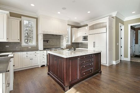 kitchen island: Kitchen in new construction home with center island