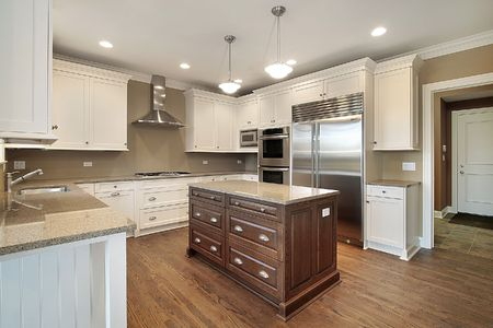 Kitchen in new construction home with center island photo