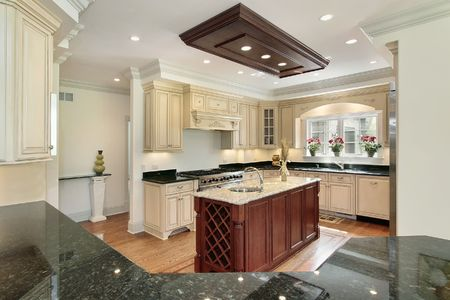 lighting fixtures: Kitchen in new construction home with center island