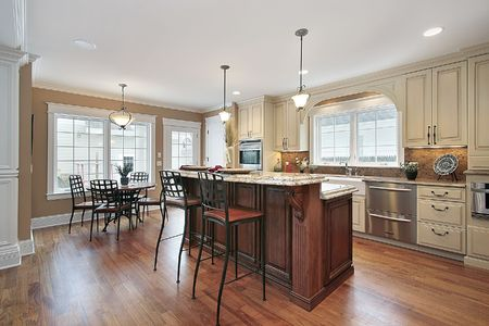 island: Kitchen in luxury home with two tiered island Stock Photo