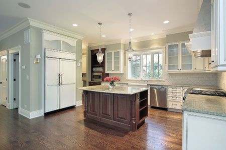 Kitchen in luxury home with large granite island photo