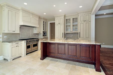 Kitchen in new construction home with large island photo