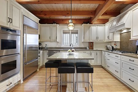 Kitchen in luxury home with wood ceiling beams photo