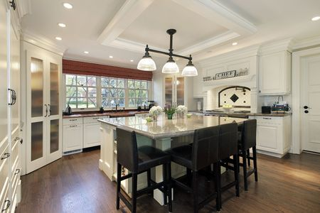 kitchen island: Kitchen in luxury home with large center island