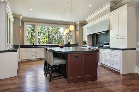 Kitchen in luxury home with gray granite island photo