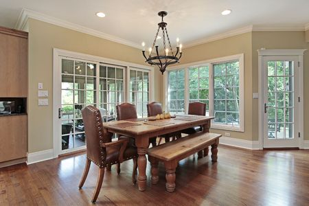 upscale: Eating area of upscale home with porch view Stock Photo