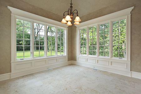 Eating area in luxury home with back yard view photo